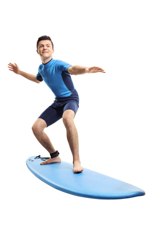 Full length portrait of a teenage boy surfing isolated on white background