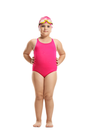 Full length portrait of a little girl in a swimming suit, cap and googles isolated on white background
