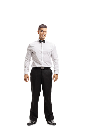 Full length portrait of a young man in a tux isolated on white background