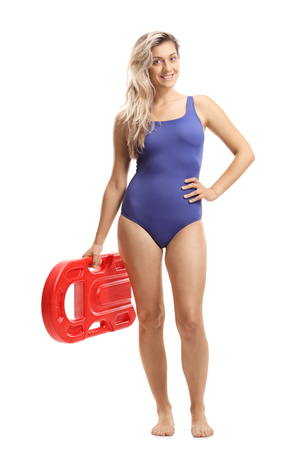 Full length portrait of a young woman in a swimming suit holding a swimming board isolated on white background