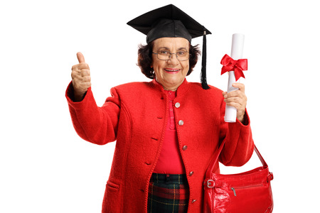 Happy elderly woman holding a graduation diploma and showing thumbs up isolated on white background
