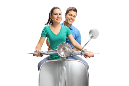 Young female and male riding a vintage scooter isolated on white background