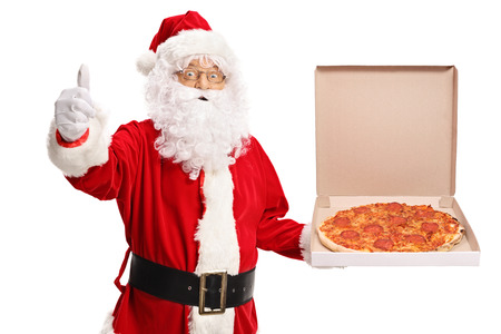 Santa Claus holding a pizza box and making a thumb up sign isolated on white background Stock fotó