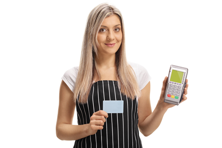 Waitress holding a credit card and a payment terminal isolated on white background
