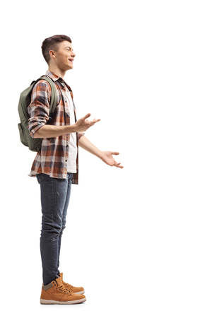 Full length profile shot of a teenage student standing and talking
