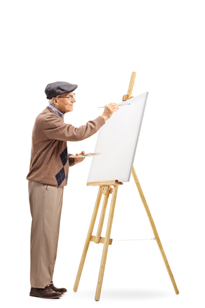 Full length shot of a senior male artist painting on a canvas isolated on white