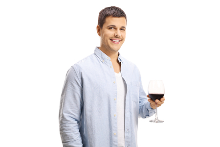 Young man holding a glass of red wine isolated on white