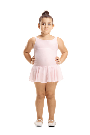 Full length portrait of a little girl in a pink ballet dress posing isolated on white