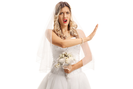 Angry bride gesturing stop with her hand isolated on white background