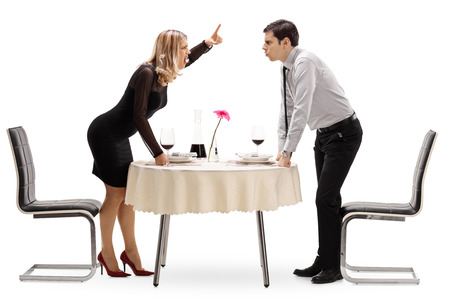 Full length shot of a young couple arguing at a restaurant table isolated on white background Banque d'images