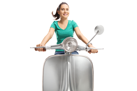 Cute young female riding a vintage scooter isolated on white background