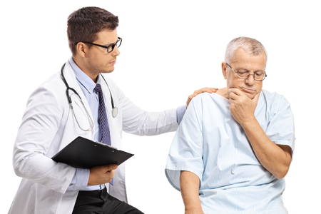 Male doctor with a worried elderly patient isolated on white background