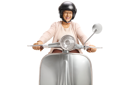 Cheerful senior woman with a helmet riding a vintage scooter isolated on white Standard-Bild