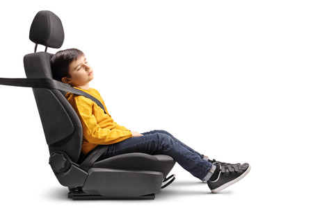 Kid sleeping in a car seat isolated on white 版權商用圖片