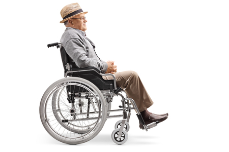 Full length profile shot of an elderly man sitting in a wheelchair isolated on white background