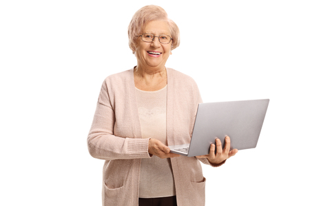 Happy senior woman holding a laptop computer isolated on white background