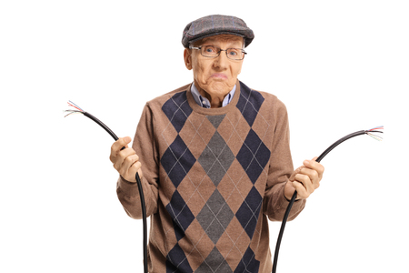 Confused elderly man holding a broken cable isolated on white background