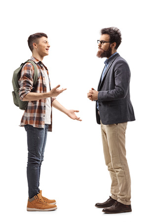 Full length shot of a teenage male student talking to his father isolated on white background