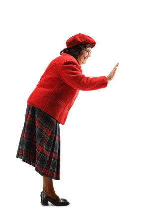 Full length shot of a senior woman gesticulating high five with hand isolated on white background