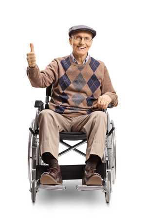 Full length portrait of an elderly disabled man in a wheelchair showing thumbs up isolated on white background Imagens