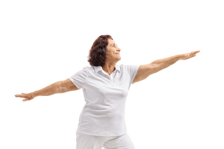 Senior woman spreading her arms isolated on white background Reklamní fotografie