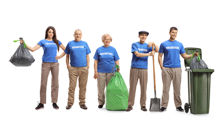 Full length portrait of a group of volunteers cleaning waste isolated on white background