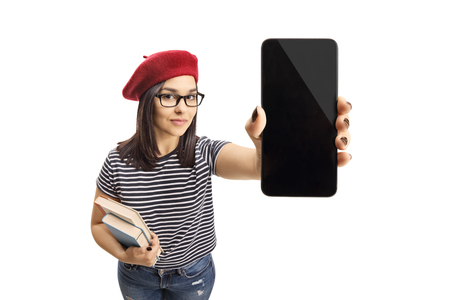 Young female holding books and a smartphone isolated on white background Stock fotó