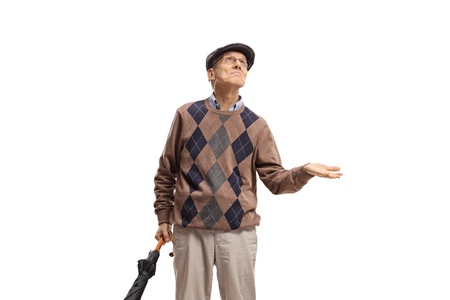 Elderly man with an umbrella checking to see if it is raining isolated on white background