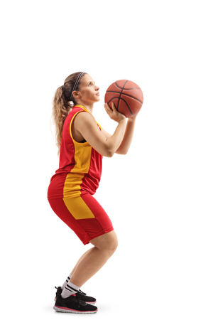 Full length shot of a female basketball player shooting a free throw isolated on white background 版權商用圖片