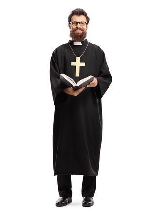 Full length portrait of a father priest with a cross and bible isolated on white background