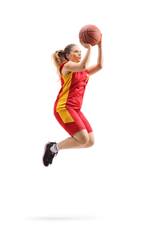 Female basketball player rjumping and shooting a ball isolated on white background