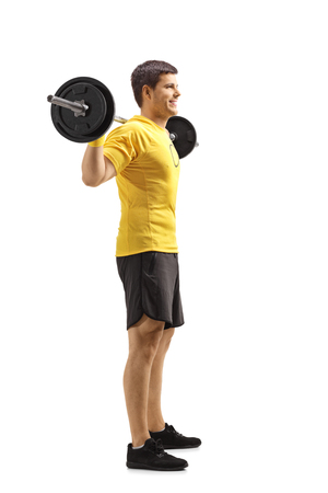 Full length shot of a young man standing and lifting weights on shoulders isolated on white background