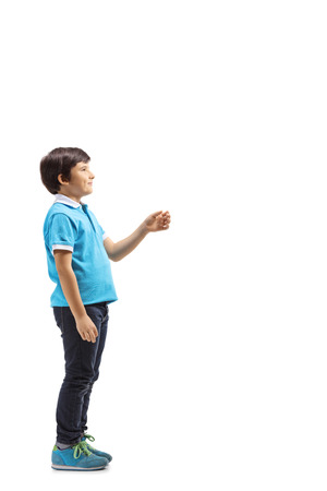 Full length profile shot of a child waiting and gesturing with hand isolated on white background