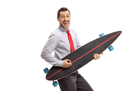 Cheerful businessman pretending to play guitar on a longboard isolated on white background