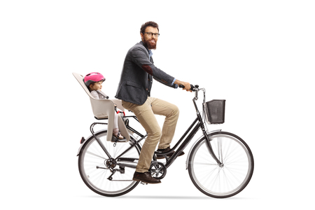 Bearded man riding a little child on a bicycle and looking at the camera isolated on white background 版權商用圖片 - 124717084