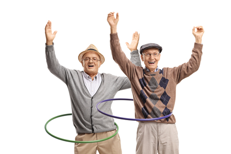 Two cheerful senior men spininng hula hoops isolated on white background Reklamní fotografie