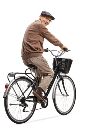 Full length shot of a cheerful senior man riding a bicycle and smiling at the camera isolated on white background Reklamní fotografie