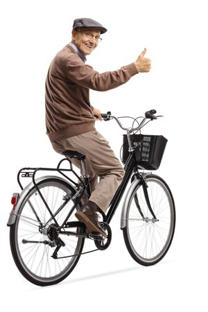 Full length shot of a cheerful elderly man on a bicycle giving thumbs up isolated on white background