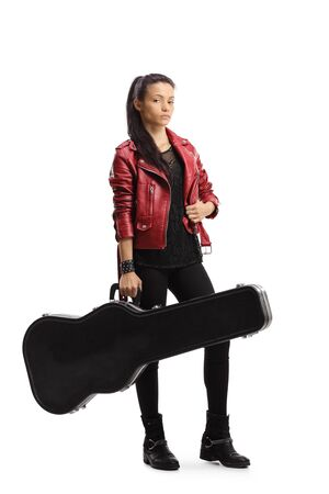 Full length portrait of a female musician posing with a guitar case isolated on white background