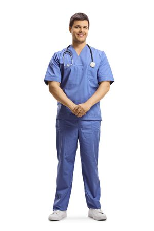 Full length portrait of a young male doctor in a blue uniform posing and smiling isolated on white background
