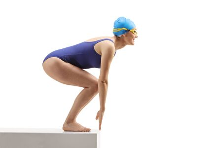Full length shot of a woman with a swimming suit getting ready to jump isolated on white background