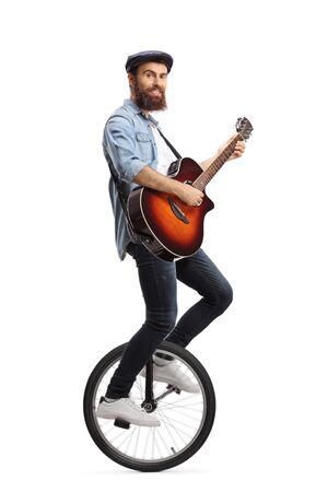 Full length shot of a bearded guy riding a unicycle and playing a guitar isolated on white background