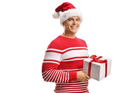 Young man wearing a santa claus hat and holding a christmas gift box isolated on white background