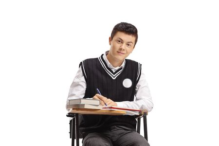 Male student in a school chair taking notes and looking at the camera isolated on white background Reklamní fotografie