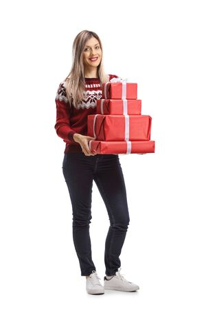 Full length portrait of a pretty young woman holding a pile of presents isolated on white background Reklamní fotografie