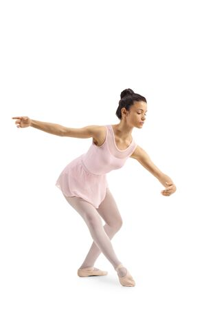 Full length shot of a young female ballet dancer performing a classical pose isolated on white background