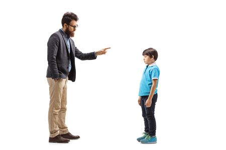 Full length profile shot of a father scolding his son isolated on white background