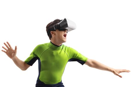 Young guy in a wetsuit with a VR headset isolated on white background