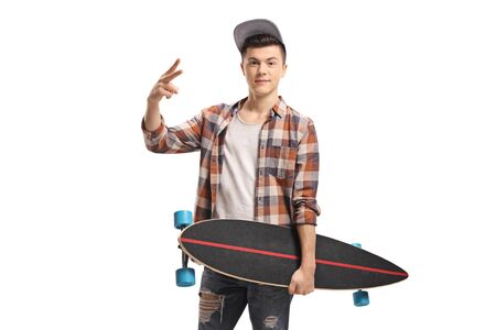 Young guy with a longboard making a peace sign isolated on white background