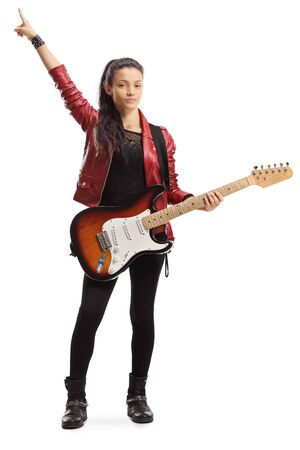 Full length portrait of a female with a bass guitar standing and pointing up isolated on white background